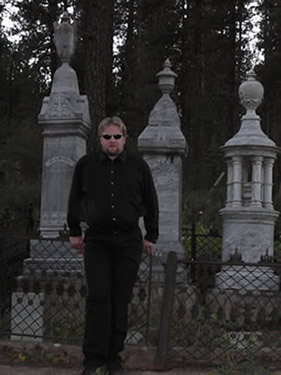 Scott in front of headstones